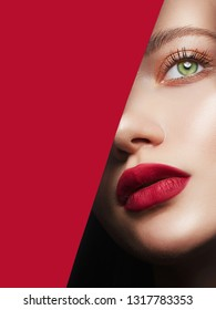 beautiful woman with a makeup, into the hole of red paper. make-up artist concept. beauty girl with beautiful bright green eyes and red Lips