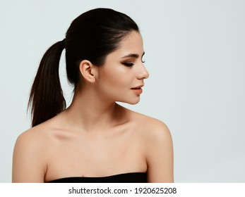 beautiful woman with makeup naked shoulders side view