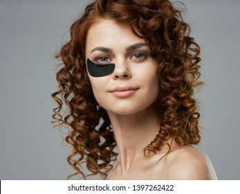 beautiful woman with makeup on the face cosmetology skin care spa treatments gray background pattern