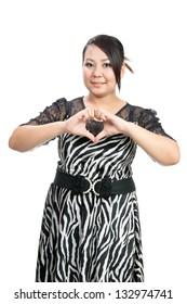 Beautiful Woman Making Heart Shape Sign against smile