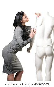 Beautiful woman and a male mannequin on a white background