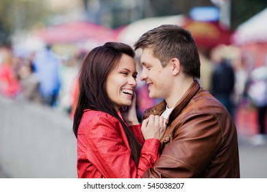 beautiful woman and man smiling on the background of people