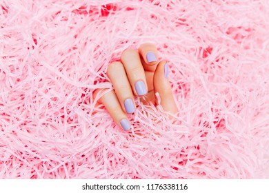 Beautiful woman manicure on creative trendy pink paper background. Minimalist manicure trend. Top view, flat lay.