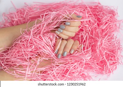 Beautiful woman manicure on creative trendy pink background. Art manicure trend. Top view. Flat lay style.