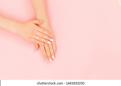 Beautiful woman manicure on creative trendy pink background. Minimalist manicure trend. Top view, flat lay. Copy space for text.