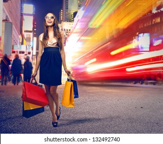 beautiful woman with many shopping bags