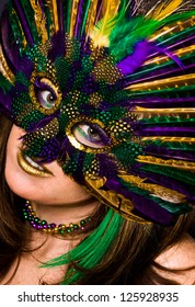 Beautiful Woman in Mardis Gras Mask and Makeup