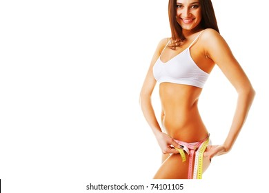 Beautiful woman measuring her perfect shape on white background
