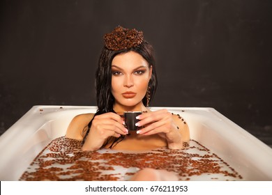 beautiful woman in the milk bath with coffee beans