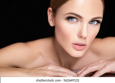 beautiful woman model with no makeup and clean healthy skin face on black background
