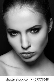 Beautiful woman model portrait black and white closeup . Black background