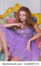 beautiful woman model posing in elegant dress in the studio.