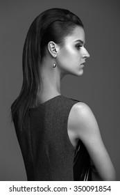 beautiful woman model posing in elegant dress in the studio. Black and white
