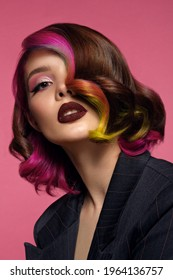 Beautiful woman with multi-colored hair and bright make up and hairstyle.