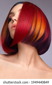 Beautiful woman with multi-colored hair and creative make up and hairstyle. Beauty face.
