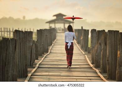 The beautiful woman Myanmar in during sunrise , Ubein bridge, Mandalay Myanmar,vintage style