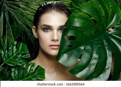 beautiful woman naked shoulders green leaves lifestyle
