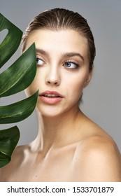 Beautiful woman naked shoulders palm leaf nature charm skin care health