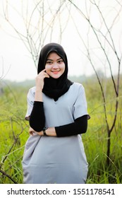 beautiful woman named lisa who is smiling in a meadow in the country of indonesia taken in july 2019