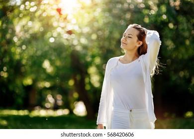 Beautiful woman in nature enjoying good weather
