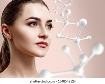 Beautiful woman near big white molecule chain. Over beige background.