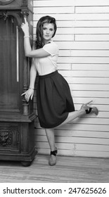 Beautiful woman near the vintage clock