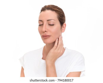 Beautiful woman with neck pain, isolated on white background.