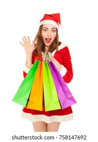 Beautiful woman in new year costume with colorful shopping bags isolated on white