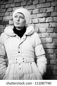 beautiful woman next to brick wall,retro style