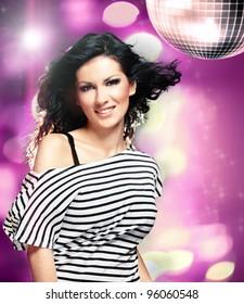 Beautiful woman in a nightclub with big disco ball
