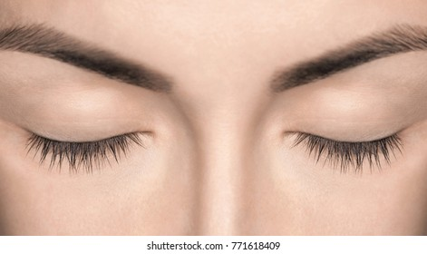 A beautiful woman with not extensible eyelashes in a beauty salon. Eyelash extension procedure