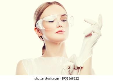 Beautiful woman nurse put on rubber gloves, medical uniform
