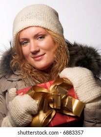 beautiful woman offering a christmas gift