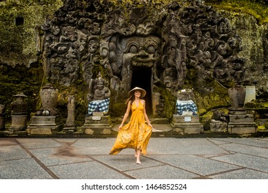Beautiful woman in old hindu temple of Goa Gajah near Ubud on the island of Bali, Indonesia