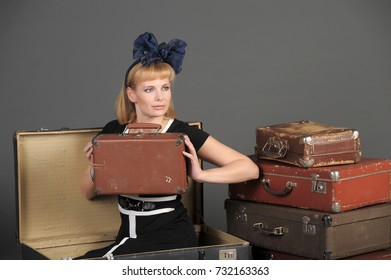 The beautiful woman with old retro suitcases