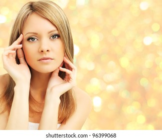 Beautiful woman on abstract golden background