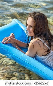 beautiful  woman on an air mattress on the sea