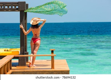 beautiful woman on background of ocean