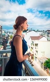 Beautiful woman on a balcony in Dalat, Vietnam.