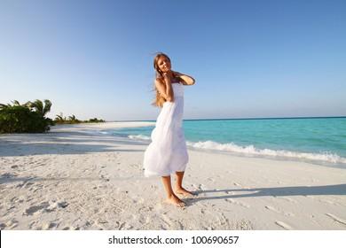 Beautiful woman on the beach, maldives