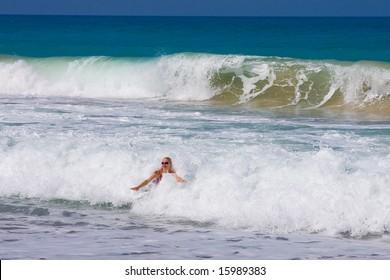 a beautiful woman on the beach in Mediterranean