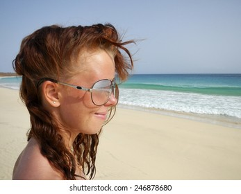 Beautiful woman on beach with white sand