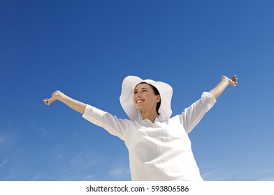 beautiful woman  on the blue sky background