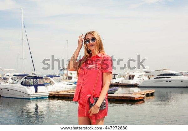 Beautiful woman on the boat station