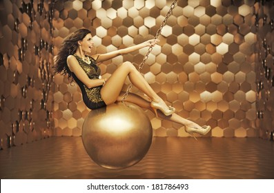 Beautiful woman on a gold ball