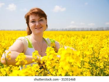 beautiful woman on the rapeseed field