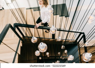 Beautiful woman on the stairs