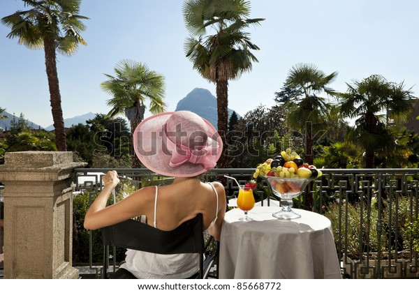 beautiful woman on the terrace of prestigious hotel, portrait