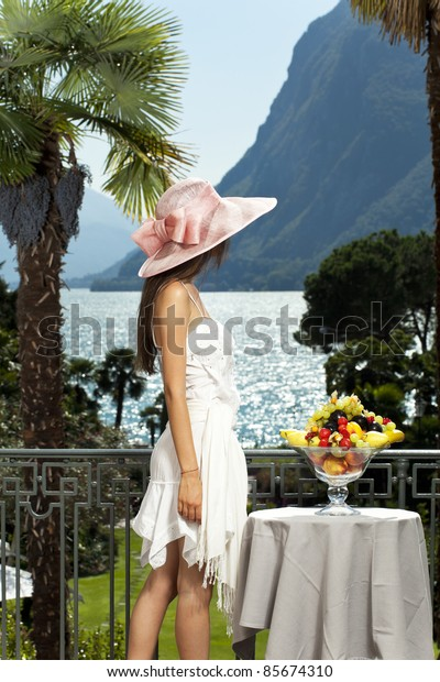beautiful woman on the terrace of prestigious hotel, portrait