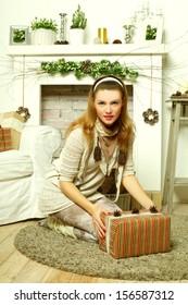 Beautiful woman open Christmas gift box